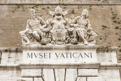 Sculptures above an entrance to the Vatican Museums in Rome, Italy