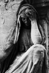 Sculptures from the Pere Lachaise Cemetery Paris, France (dark key photo)