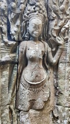 Sculptures of Apsara dancers on the temple wall in Angkor Wat temple. Khmer temple. Unesco World Heritage Site. Siem Reap Province. Cambodia. South-East Asia