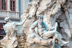 Sculptures of Fontana dei Quattro Fiumi Piazza Navona in Rome Italy . Sculptures of mythological gods . Marble craft figures