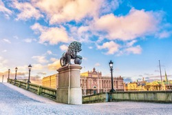 Sculptures of lions near the main staircase of the Royal Palace of Stockholm and a view of the Parliament Building (Riksdagshuset) in Stockholm, the capital of Sweden