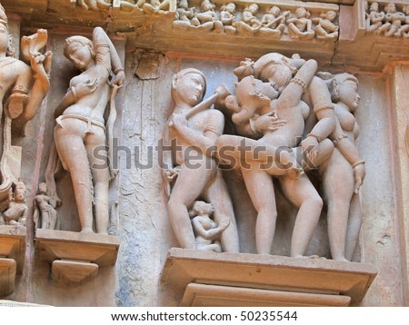 Sculptures of loving couples, illustrating the Kama Sutra, on walls of  Varaha Temple, Khajuraho in  India, Asia - stock photo