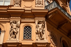 Sculptures on facade of old stock exchange building in Riga