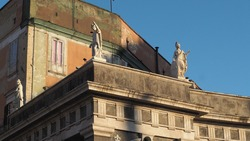 sculptures on the roof with a sunset light in naples italy