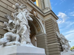 Sculptures with angels and demons on the outside of Italian baroque Odessa National Academic Theatre of Opera and Ballet.