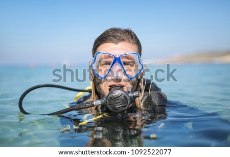 Scusa diver ready to dive in the sea