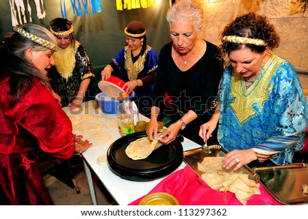SDEROT-APRIL 27:Jewish celebrates the traditional North African Jewish celebration Mimouna, day after the end of Passover on Apr 27 2008 in Jerusalem,Israel.It marks the return to eat leavened bread.