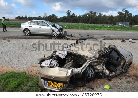 SDEROT, ISR - DEC 12:Traffic policeman in a deadly car accident scene on Dec 12 2008.According to the World Health Organization:1.2M people are killed in traffic accidents each year around the world