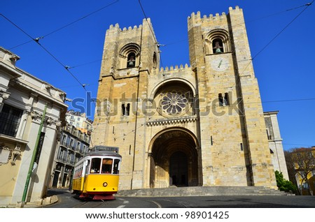 Se Cathedral (oldest church, from XIIth century) and Yellow Tram (Americanos), two symbols of Lisbon, Portugal