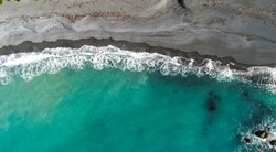 Sea aerial view,Top view, amazing nature background.The Color of the water and beautifully bright. Aerial view over black sand beach and Green Ocean at New Zealand.