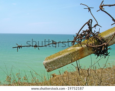 Sea and barbed wire