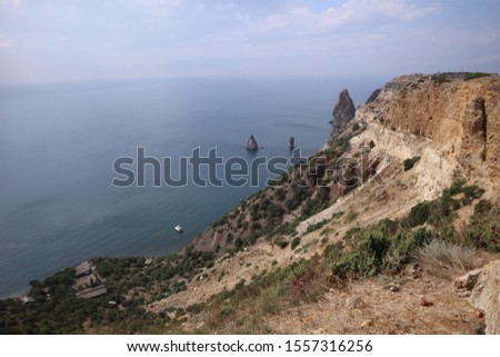 Sea and cliff view, you can also see horizont and clouds