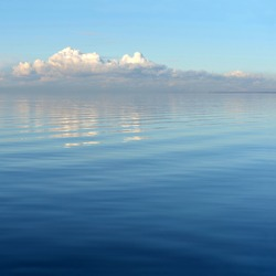 Sea and clouds reflected