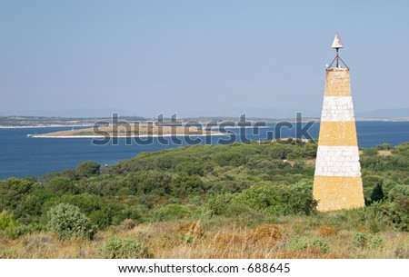 Sea and lighthouse in the protected natural area of Premantura peninsula near Pula (Pola), Istra, Croatia