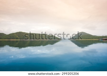 Stock Photo Sea and mountains against the sky