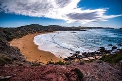 sea and rocks on cavalleria beach, menorca, spain