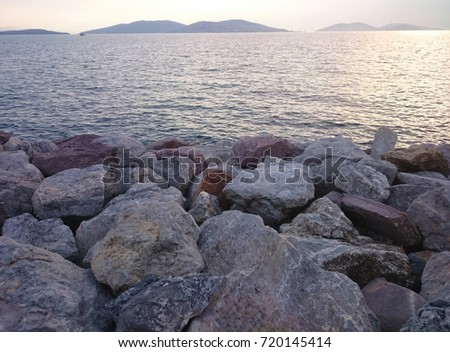 Sea and stones with sunset view