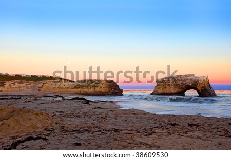 Natural Landforms Made by Erosion http://www.shutterstock.com/pic-38609530/stock-photo-sea-arch-formed-by-wave-erosion-at-natural-bridges-state-park-at-the-sunset.html