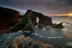 Sea Arch known as Stac A Phris at golden hour sunset. Located on the isle of Lewis, Outer Hebrides, Scotland.
