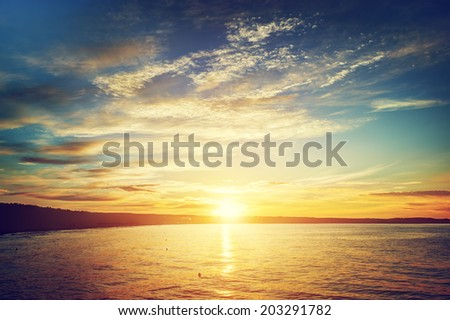 Sea at sunset background. Gdansk, Sopot in Poland. Baltic sea. #203291782