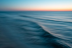 Sea at sunset with intentional camera movement, motion blur