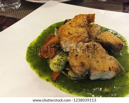 Sea bass fillet with pesto sauce