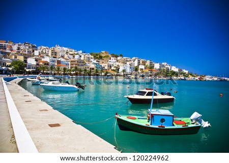 Sea bay with moored boats, promenade in Mediterranean town Sitia Greece Crete