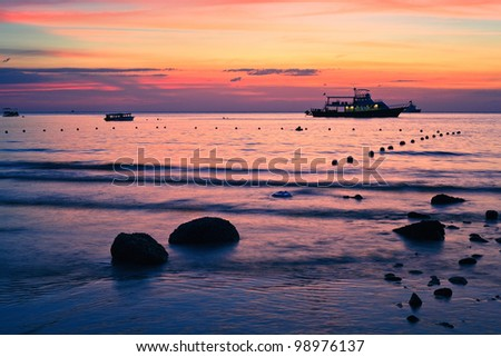 Sea beach and rock on sunset time