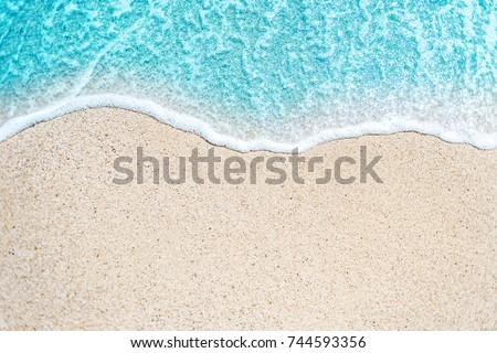 Sea Beach and Soft wave of blue ocean.  Summer day and sandy beach background  #744593356