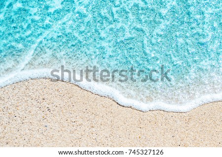 Sea Beach and Soft wave of blue ocean.  Summer day and sandy beach background.  #745327126
