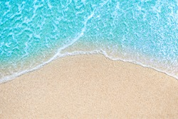 Sea Beach and Soft wave of blue ocean.  Summer day and sandy beach background concept.