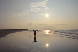 sea beach of sagar island, a man enjoying morning view of vast sea