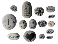 Sea beach pebbles isolated on white. Smileys painted on sea pebbles. Sea travel vacation art pictures on sea thematics.