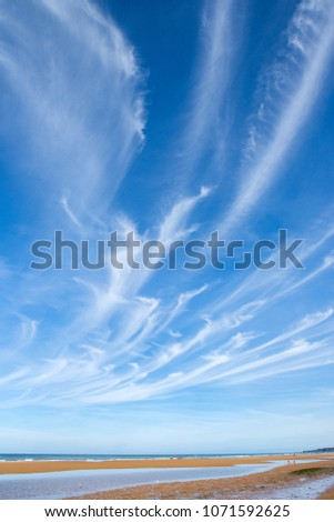 Sea beach view with cirrus clouds above.