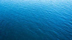 Sea blue water surface texture background, aerial view, vacation travel concept