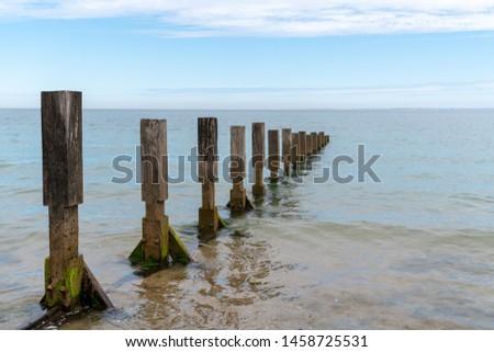 sea breakwater breaking the waves ocean atlantic in Ile de Noirmoutier France Vendee #1458725531
