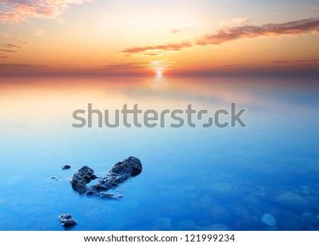 Sea coast during bright sundown. Natural summer seascape