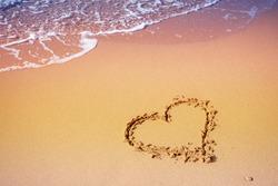 Sea coast. Inscription heart on beach sand
