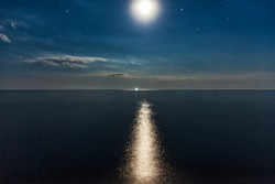 Sea coast, night, moon, stars.