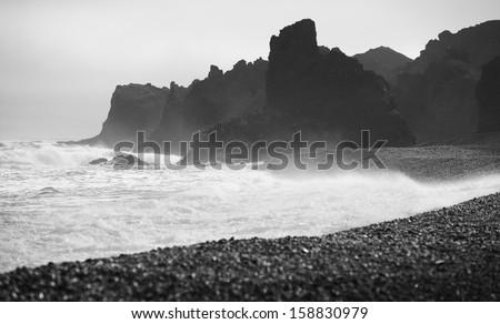 Sea coast volcanic rocks and black beach sand at Snaefellnes Peninsula Iceland black and white