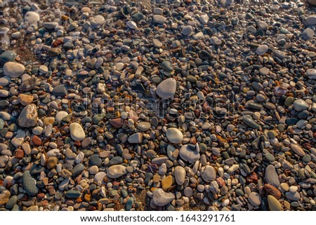sea cost stones texture background pebbles background pebble beach pattern