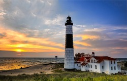 Sea dawn at the lighthouse. Lighthouse at dawn. Sunrise lighthouse scene