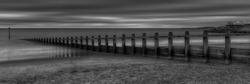 Sea defences at Dawlish Warren in B&W