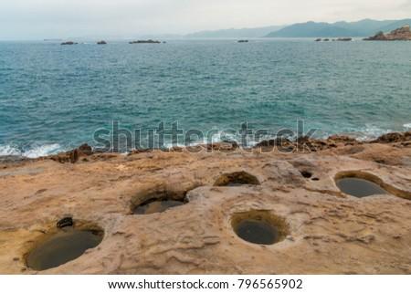 Sea-eroded potholes at the coastline  of Yehliu Geopark, Taipei, Taiwan. #796565902