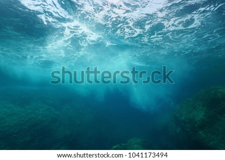Sea foam formed by wave breaking on rock, seen from underwater, Mediterranean sea, Cote d'Azur, France