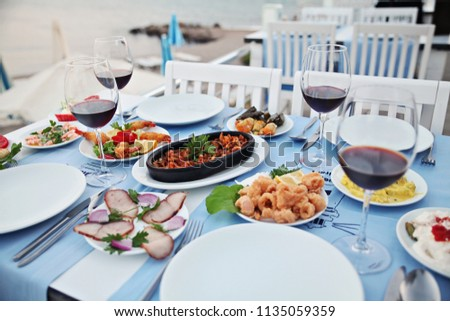 Sea food and wine at an Aegean restaurant