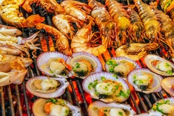 Sea Food scallop seashell muscle mussel oyster Cooking Barbecue Fire Grill Close-up Background