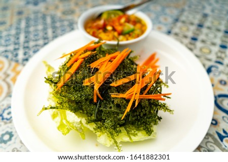 Sea grape is  seaweed to cooking  salad that eat with Thai spicy dressed salad. Green caviar or Umibudo is nutritious food.