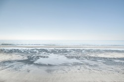 Sea horizon and white sandy beach. Vada, Tuscany, Italy.  High key photography