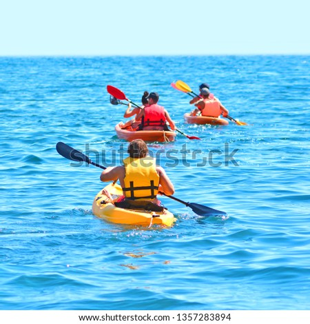 Sea Kayaks. Kayaking and canoeing together background.